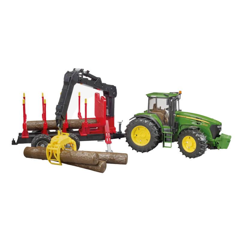 John Deere 7930 traktor közelítőkocsival és 4 farönkkel